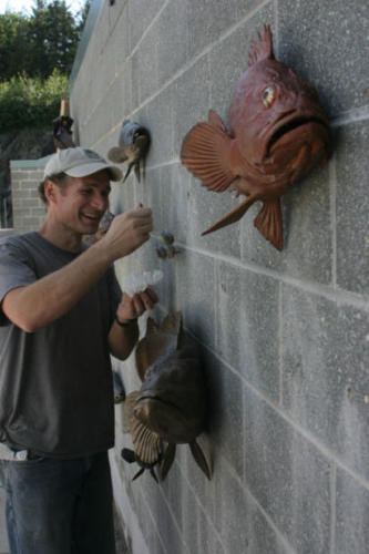 Gary Staab putting the finishing touches on a bronze rockfish