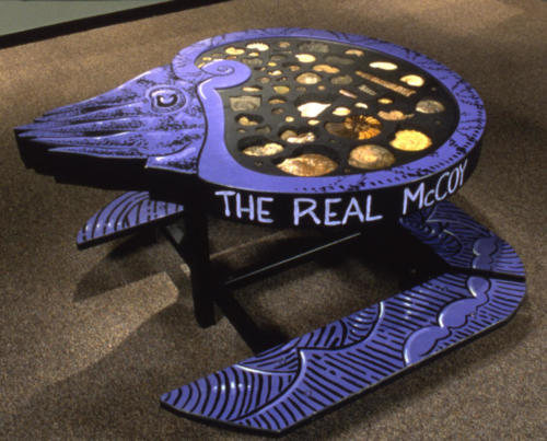 Ammonite fossil table designed and built by the exhibits department at DMNS