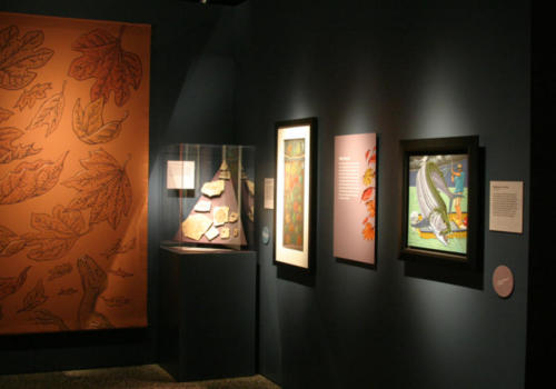 Original artworks, text panels, and a projection painting on canvas