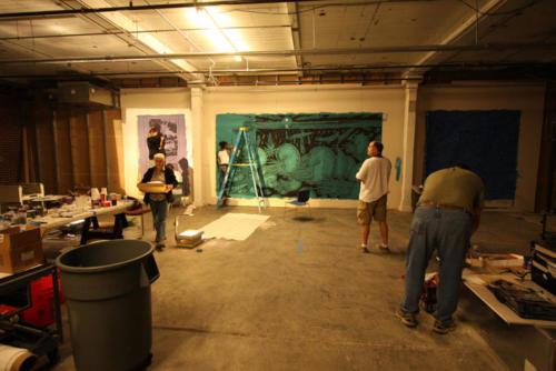 Projection paintings in progress with a crew of volunteers