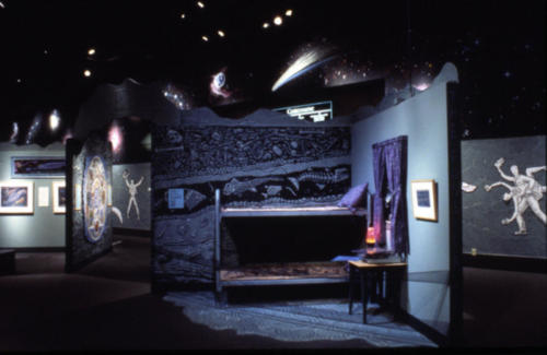 "The surreal ""fossil bedroom"" area showing strata layers and fossils"