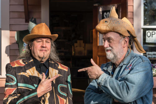 Tlingit artist Tommy Joseph, left, wears a suit he designed while Ray wears a ratfish helmet carved by Joseph.
